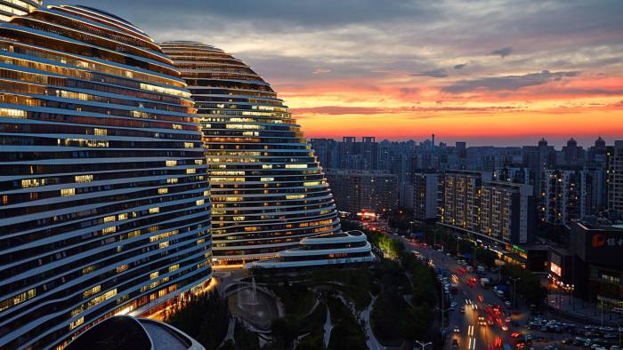 Wangjing's Soho building: analysts fear areas such as the Beijing suburb face a perfect storm of overcapacity, demographic shifts and the potential for local debt crises