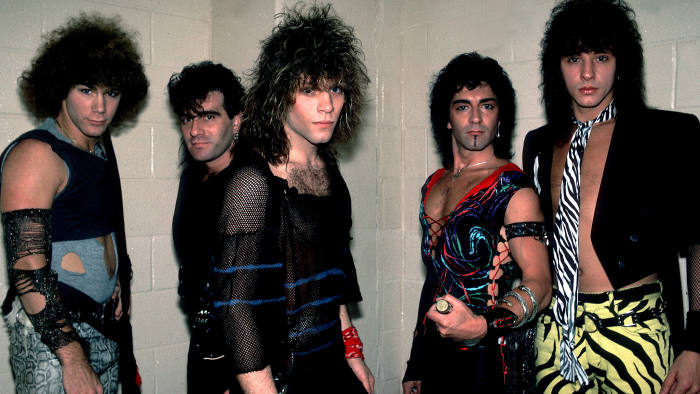 Portrait of American rock band Bon Jovi backstage before a performance at the Rosemont Horizon, Rosemont, Illinois, May 20, 1984. Pictured are, from left, David Bryan, Tico Torres, Jon Bon Jovi, Alec John Such, and Richie Sambora. (Photo by Paul Natkin/Getty Images)