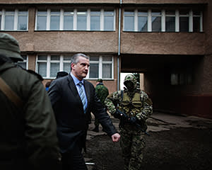 New prime minister Sergei Aksyonov inspects the Crimean army