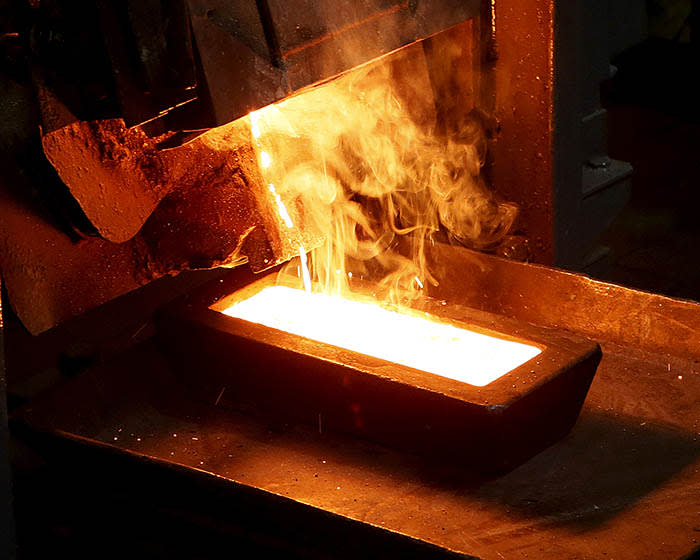 FILE PHOTO: A melter casts an ingot of 92.96 percent pure gold at a procession plant of the Olimpiada gold operation, owned by Polyus Gold International company, in Krasnoyarsk region, Eastern Siberia, Russia, June 30, 2015. Picture taken June 30, 2015. REUTERS/Ilya Naymushin/File Photo