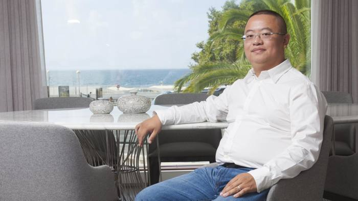 """Edmund Zhao at his offices in Estoril, near Lisbon where he has set up a business to help other wealthy Chinese property buyers. The day after he arrived in Portugal he bought a 500,000 apartment that enabled him to obtain a """"golden residence permit""""."""