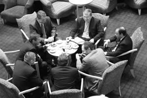 Yukos's Khodorkovsky (centre right) and Sibneft's Roman Abramovich (left profile) agree a $36bn merger, April 22 2003, six months before Khodorkovsky's arrest