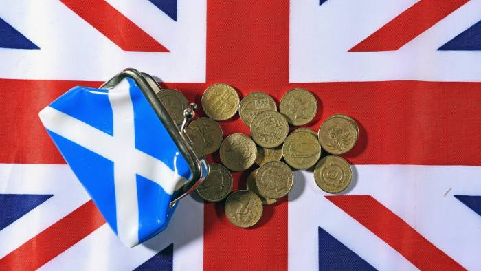 GLASGOW, SCOTLAND - AUGUST 20: In this photo illustration, pound coins are placed on a Union Jack flag on August 20, 2014 in Glasgow, Scotland. First Minister Alex Salmond's, chief economic adviser has insisted Scotland has viable options for its currency if there is a yes vote in the independence referendum on September the18th. (Photo by Jeff J Mitchell/Getty Images)
