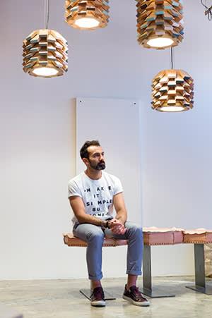 Khalid Shafar seated on his 'Octa' bench beneath 'Palm' lights
