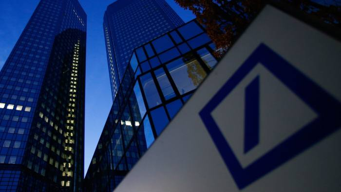 Headquarters Of Deutsche Bank AG Following Settlement Of Allstate Mortgage Securities Suit...A logo sits on display in front of the Deutsche Bank AG headquarters at dawn in Frankfurt, Germany, on Tuesday, Dec. 31, 2013. Deutsche Bank AG and Allstate Corp. settled a suit the insurer brought that accused the bank of misrepresentations and omissions in connection with loans backing $185 million in mortgage securities. Photographer: Ralph Orlowski/Bloomberg