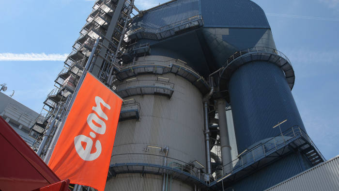 An E.On AG flag flies in front of the carbon dioxide (CO2) capture and storage unit at the E.On AG Staudinger coal-powered plant in Grosskrotzenburg, Germany, on Sunday, June 27, 2010. E.On AG may sell its 3.5 percent stake in Russia's natural-gas monopoly OAO Gazprom, Interfax reported, citing unidentified people. Photographer: Hannelore Foerster/Bloomberg