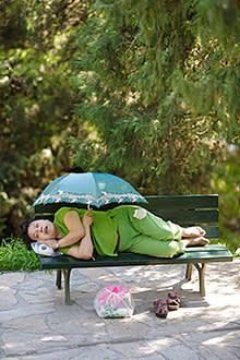A woman takes a nap