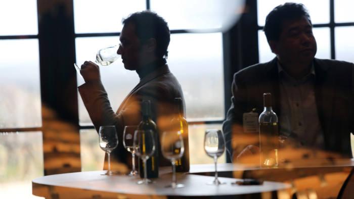 "Two men taste the new 2012 Chateau Rayne-Vigneau Bordeaux vintage wine in Sauternes on April, 8, 2013, on the first day of the annual ""Bordeaux primeur wines week"" ('Semaine des primeurs des Vins de Bordeaux' in French). AFP PHOTO"