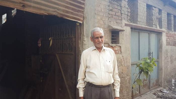 Omkar Sharma, 60, who owns a small worship that had 12 workers making bolts and hinges for doors