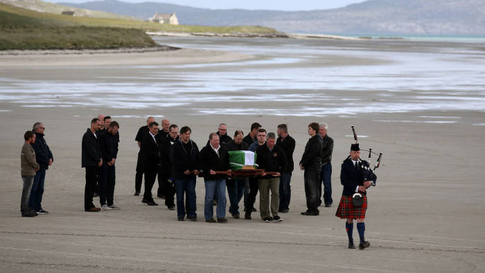 BARRA, SCOTLAND - JUNE 4: The coffin of Eilidh MacLeod draped in the Barra flag is carried across Traigh Mhor beach at Barra airport after it arrived by chartered plane on June 4, 2017 in Barra, Scotland. The body of the Manchester bomb victim was flown home to the devastated community on the island of Barra ahead of her funeral. The 14-year-old was among 22 people who died in the terrorist attack at the Ariana Grande concert on Monday May 22, which also left dozens injured. Photo by Andrew Milligan - WPA Pool / Getty Images)***BESTPIX***