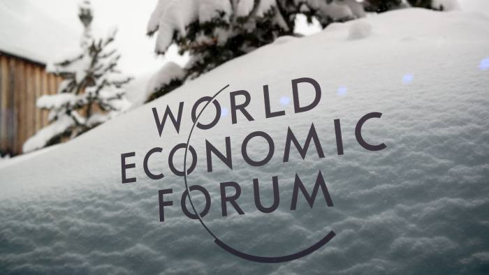 A picture taken on January 21, 2018 shows the logo of the World Economic Forum (WEF) under the snow on the eve of the opening day of the WEF 2018 annual meeting in Davos. US President Donald Trump's participation at the World Economic Forum in Davos, Switzerland next week could be thrown into question now that the federal government has partially shut down over budget wrangling, the White House said Saturday. / AFP PHOTO / Fabrice COFFRINIFABRICE COFFRINI/AFP/Getty Images