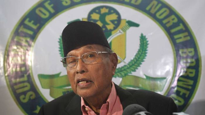 Former Sultan of Sulu Jamalul Kiram III answers questions during a news conference inside his residence at Maharlika village