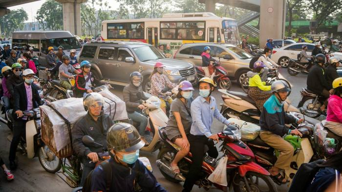 Vietnam's drivers trade up from two wheels to four