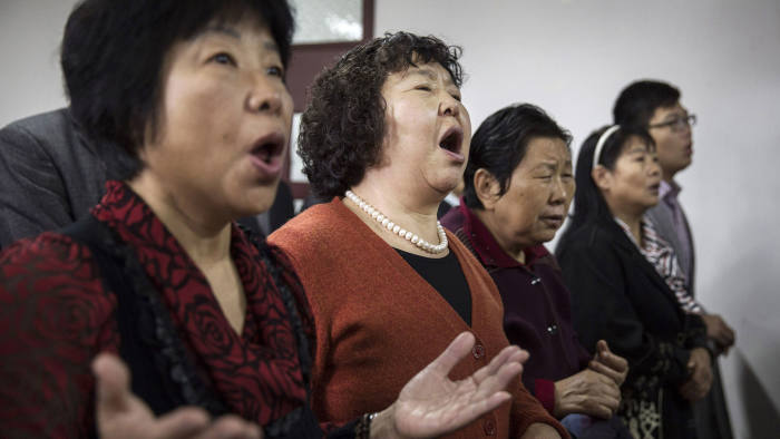 BEIJING, CHINA - OCTOBER 12:(CHINA OUT):Chinese Christians sing during a prayer service at an underground independent Protestant Church on October 12, 2014 in Beijing, China. China, an officially atheist country, places a number of restrictions on Christians and allows legal practice of the faith only at state-approved churches.?The policy has driven an increasing number of Christians and Christian converts 'underground' to secret congregations in private homes and other venues. While the size of the religious community is difficult to measure, studies estimate there more than 65 million Christians inside China with studies supporting the possibility it could become the most Christian nation in the world within a decade.  (Photo by Kevin Frayer/Getty Images)