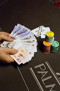 money, chips and cards on a poker table