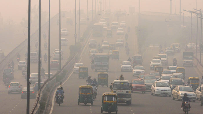 NEW DELHI, INDIA - NOVEMBER 3: People commute amidst smog on a cold morning on November 3, 2015 in New Delhi, India. Air quality in surrounding areas of Delhi has dropped dramatically due to practice of burning of crop residues. According to reports, satellite image from NASA's Earth Observing System Data and Information System (EOSDIS) website recently showed fire spots, which denote blazes on the ground, all across Punjab and parts of northern Haryana. Deterioration in air quality is aggravating respiratory problems. (Photo by Sonu Mehta/Hindustan Times via Getty Images)