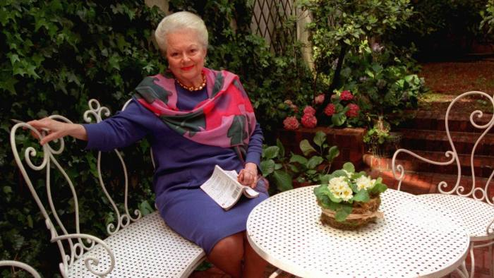 """ADVANCE FOR WEEKEND EDITIONS, MAY 23-25 -- Olivia de Havilland, the Oscar-winning actress who played the charitable and loving Melanie in """"Gone With The Wind"""", sits in the garden ofher Paris home, April 15, 1997. Although de Havilland has not acted since 1988, when she appeared in a television movie """"The Woman He Loved,"""" she insists she is not retired. (AP Photo/Michel Lipchitz)"""