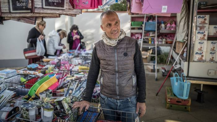 Picture by Charlie Bibby for the Financial Times Europopulism with James Politi in Cascina, Italy. Roberto Luppichini at the market in Navacchio