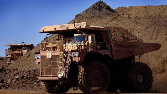 26 July, 2006 - PIC: JACK ATLEY/ BLOOMBERG NEWS - STORY: RIO TINTO MINE - PIC SHOWS: A heavy earth moving truck is seen inside the Tom Price Iron Ore mine, operated by Rio Tinto, in north Western Australia, Australia, Wednesday 26 July, 2006. Photographer: Jack Atley/Bloomberg News.