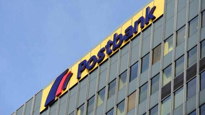 The logo of German bank Postbank is seen on the bank's branch in Berlin on April 20, 2015. Staff at German bank Postbank launched an indefinite strike Monday in eastern parts of the country, amid growing speculation parent company Deutsche Bank plans to sell off the subsidiary. AFP PHOTO / JOHN MACDOUGALL (Photo credit should read JOHN MACDOUGALL/AFP/Getty Images)