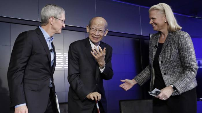 Tim Cook, Taizo Nishimuro, Ginni Rometty...Apple CEO Tim Cook, Japan Post CEO Taizo Nishimuro, and IBM CEO Ginni Rometty, left to right, get together after a news conference at IBM Watson headquarters, in New York, Thursday, April 30, 2015. Apple, IBM and Japanese insurance and bank holding company Japan Post have formed a partnership to improve the lives of elderly people in the country. The program will provide iPads with apps designed to help seniors manage day-to-day lives and keep in touch with family members. (AP Photo/Richard Drew)