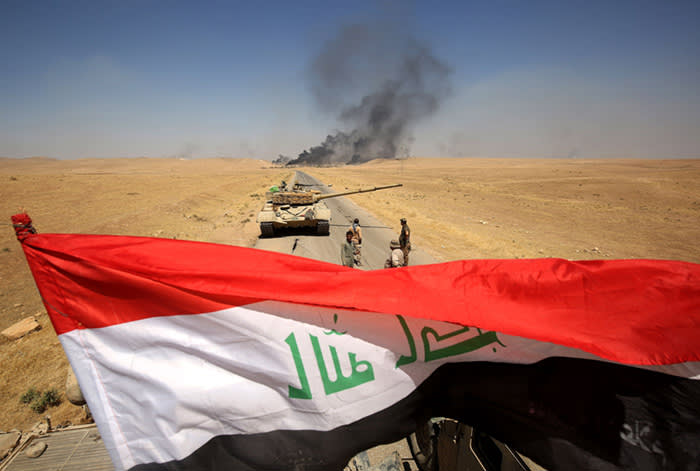 TOPSHOT - Smoke billows from the village of al-Ayadieh, near Qubuq, north of Tal Afar, as Iraqi forces advance during the ongoing operation to retake the area from the Islamic State (IS) group on August 28, 2017. Some of IS fighters inside Tal Afar were believed to have fled to Al-Ayadieh, located on the road between the city and the Syrian border, where they appeared to be making a desperate last stand. / AFP PHOTO / AHMAD AL-RUBAYEAHMAD AL-RUBAYE/AFP/Getty Images