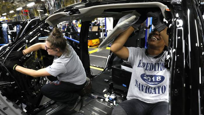 LOUISVILLE, KY - OCTOBER 27: Ford workers Jasmine Powers (right) and Cassie Bell (left), both of Louisville, Kentucky, install visors into the all-new 2018 Ford Expedition SUV as it goes through the assembly line at the Ford Kentucky Truck Plant October 27, 2017 in Louisville, Kentucky. Ford recently invested $900 million in the plant for upgrades to build the all-new Expedition and Lincoln Navigator, securing 1000 hourly U.S. jobs. (Photo by Bill Pugliano/Getty Images)