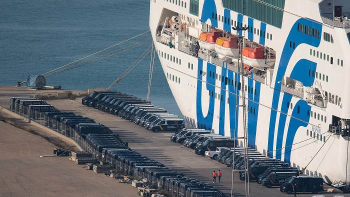 BARCELONA, SPAIN - SEPTEMBER 24: Spanish Police vans are parked next to a ferry ship, rented by the Spanish Interior Ministry to house National Police and Civil Guard police officers, at Barcelona port on September 24, 2017 in Barcelona, Spain. Spain's government announced yesterday measures to exert more control over the Catalan Autonomous Police, Mossos d'Esquadra. More than 4,000 members of the Spanis National Police and Civil Guard are being deployed in Catalonia, accomodated on three ferry boats moored at Barcelona and Tarragona ports. The Catalan goverment is keeping on its plan to hold a referendum, due to take place on Octorber 1, which has been deemed illegal by the Spanish government in Madrid. (Photo by David Ramos/Getty Images)