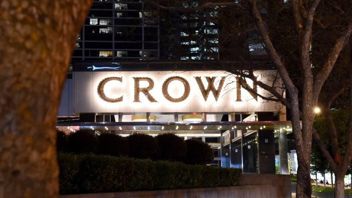 Crown Resorts Ltd. signage is displayed at the entrance to the Crown Towers hotel, part of the Crown Melbourne casino and entertainment complex, in Melbourne, Australia, on Friday, Aug. 7, 2015. Crown, the gambling company controlled by billionaire James Packer, is scheduled to report full-year results on Aug. 13. Photographer: Carla Gottgens/Bloomberg