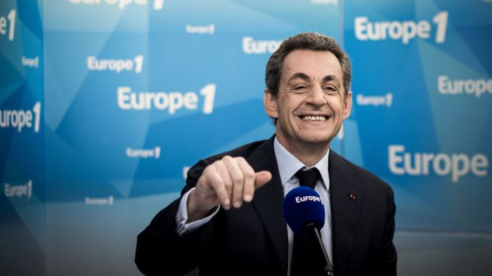 "Former French President and President of right-wing opposition Les Republicains (LR) party, Nicolas Sarkozy takes part in a live radio broadcast as part of the program ""La Matinale"" (The Early Show) on Europe 1 radio station in Paris on June 9, 2016.  Former president Nicolas Sarkozy, 61, who lost to current President Francois Hollande in 2012, has not officially declared his intention to stand as candidate in France's 2017 presidential election, but few doubt his desire for a return to the Elysee Palace under the banner of his new Republicans party. / AFP PHOTO / PHILIPPE LOPEZPHILIPPE LOPEZ/AFP/Getty Images"