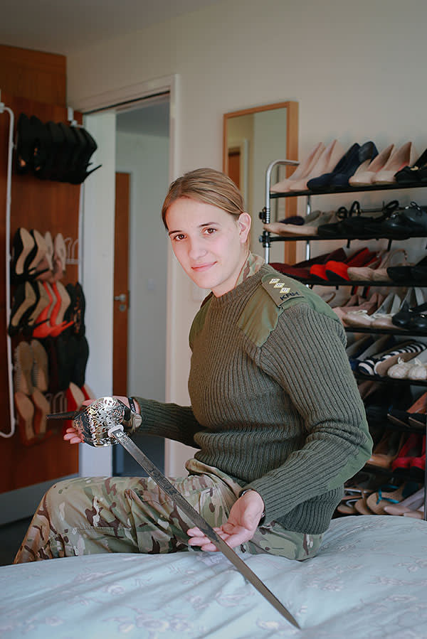 Captain Hannah Winterbourne of the Royal Electrical and Mechanical Engineers in her bedroom at Aliwal Barracks, Wiltshire