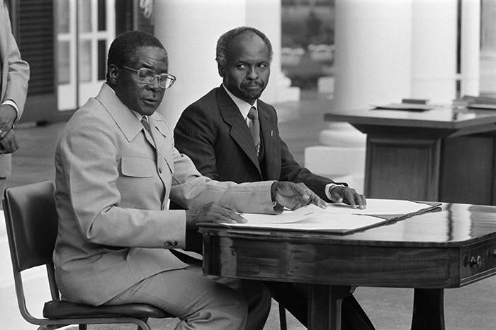 ZIMBABWE - APRIL 16: President Canaan Banana (right) and Prime Minister Robert Mugabe attend the ceremony for the independence of Zimbabwe in Salisbury, Zimbabwe on April 16, 1980. (Photo by Jean-Claude FRANCOLON/Gamma-Rapho via Getty Images)