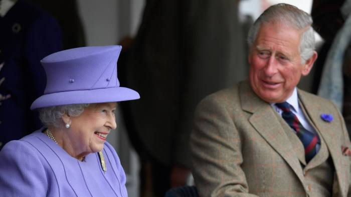 BRAEMAR, SCOTLAND - SEPTEMBER 03: Queen Elizabeth II and Prince Charles watch competitors at the Braemar Gathering on September 3, 2016 in Braemar, Scotland. There has been an annual gathering at Braemar, in the heart of the Cairngorms National Park, for over 900 years. The current gathering, in the form of a Highland Games and run by the Braemar Royal Highland Society (BRHS), takes place on the first Saturday in September and sees competitors in Running, Heavy Weights, Solo Piping, Light Field and Solo Dance watched by around 16000 spectators.   (Photo by Jeff J Mitchell/Getty Images)