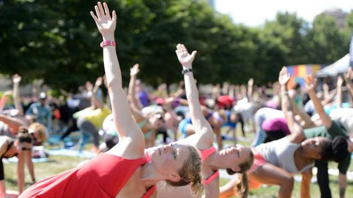 itbit Local Ambassadors Jeremy Walton and Jenny Finkel lead participants in a bootcamp and yoga workout during the launch of Fitbit Local Free Community Workouts In Chicago at Grant Park on July 16, 2016 in Chicago, Illinois.  (Photo by Daniel Boczarski/Getty Images for Fitbit)
