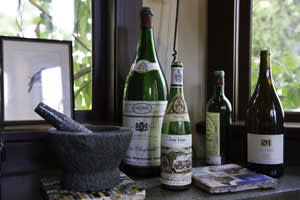 Waters's mortar and pestle with souvenir wine bottles