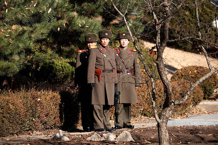 North Korean soldiers keep watch toward the south next to a spot where a North Korean has defected crossing the border on November 13, at the truce village of Panmunjom inside the demilitarized zone, South Korea, November 27, 2017. REUTERS/Kim Hong-Ji TPX IMAGES OF THE DAY