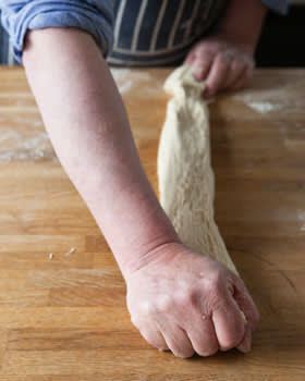 Rowley Leigh stretching a pizza dough