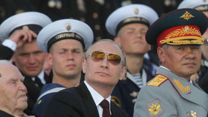 Vladimir Putin, centre, at a military parade in Severomorsk last July