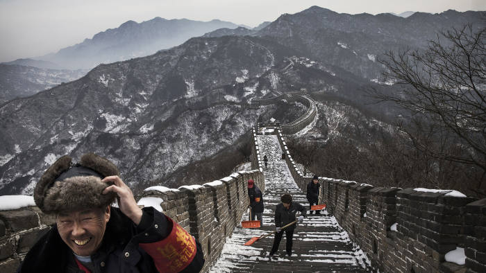 BEIJING, CHINA - FEBRUARY 22: Chinese workers shovel the steps after a snowfall on the Great Wall in Mutianyu on February 22, 2017 outside of Beijing, China. (Photo by Kevin Frayer/Getty Images)