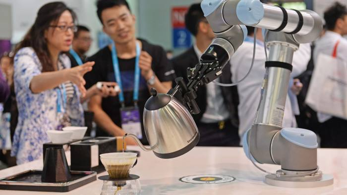 A robot makes coffee with a Bonavita pot during the first day of the Consumer Electronics Show Asia