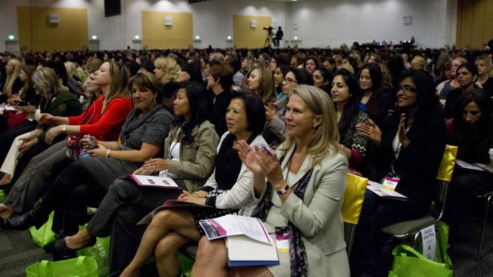 Conference attendees listen to Sheryl Sandberg, Chief Operating Officer of Facebook, speak during the 24th Annual Conference of the Professional Business Women of California, PBWC, at Moscone Center in San Francisco, CA., on Thursday, May 23, 2013. PHOTOGRAPHER: Erin Lubin/Bloomberg News