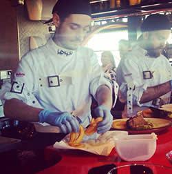 A StreetXo chef preparing a vaporised club sandwich