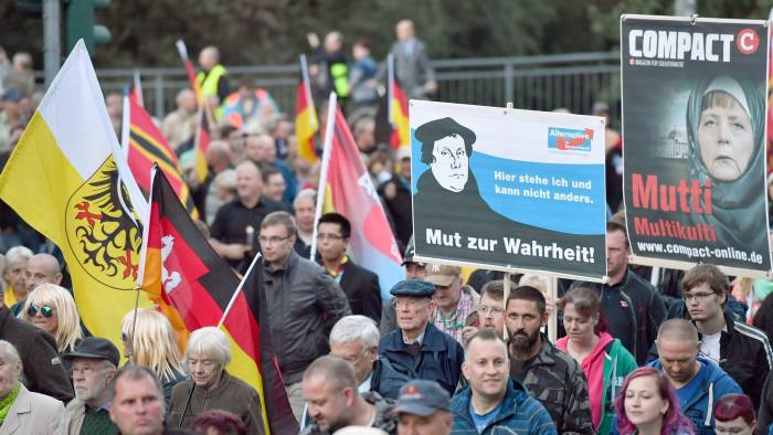 epa05550987 Participants march with banners and placards during the Alternative for Germany (AfD) party rally tittled 'protect borders, provide social security', in Erfurt, Germany, 21 September 2016. After kicking off the rally at the main station, the demonstrators moved with around 1,500 participants to the Thuringian state parliament. EPA/MARTIN SCHUTT