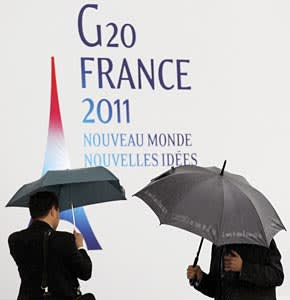 Taking cover: officials seek shelter ahead of a stormy G20 in Cannes