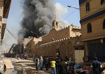 Two bombs hidden in clothing stalls went off at a market in Baghdad's Souq al-Arabi area on February 13, killing six people