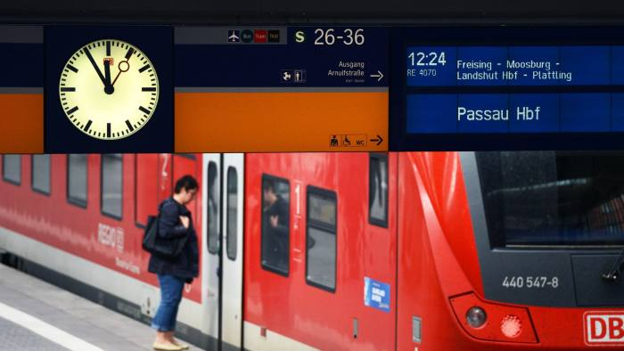 The platform clock shows five minutes prior twelve in front of a regional train of the German railway Deutsche Bahn at the central railway station in Munich, ahead of the strike of train drivers on October 15, 2014. AFP PHOTO/CHRISTOF STACHE (Photo credit should read CHRISTOF STACHE/AFP/Getty Images)
