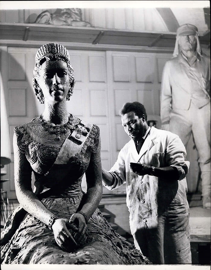 The artist at work on his figure of the Queen, c1956