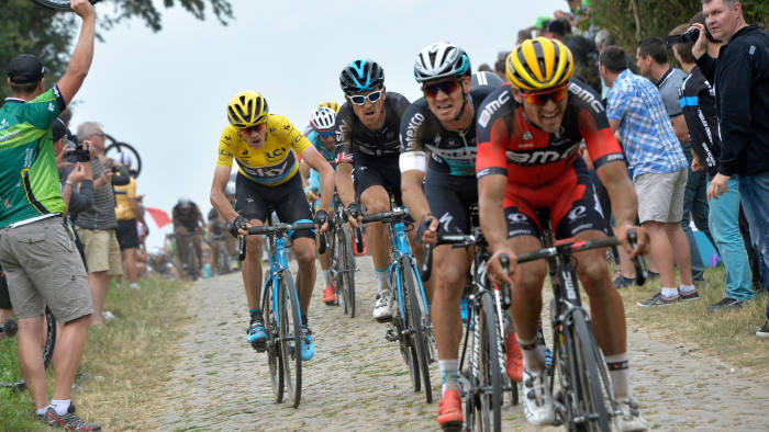 Riders negotiate cobblestones during the Tour de France on Tuesday