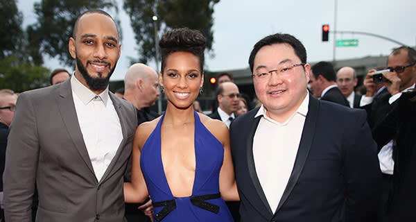 LOS ANGELES, CA - JANUARY 26: (L-R) Producer Swizz Beatz, recording artist Alicia Keys and Owner, EMI Music Publishing and Chairman EMI Music Publishing Asia Jho Low attend the 56th GRAMMY Awards at Staples Center on January 26, 2014 in Los Angeles, California. (Photo by Christopher Polk/Getty Images for NARAS)