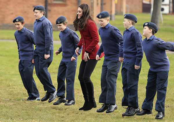 Britain's Kate, the Duchess Of Cambridge, centre, plays a game with RAF Air Cadets, during a visit to RAF Wittering, in Stamford, England, Tuesday, Feb. 14, 2017. (Stephen Pond/Pool Photo via AP)